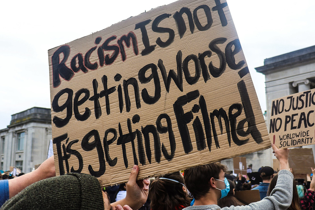protest sign racism is not getting worse it's getting filmed