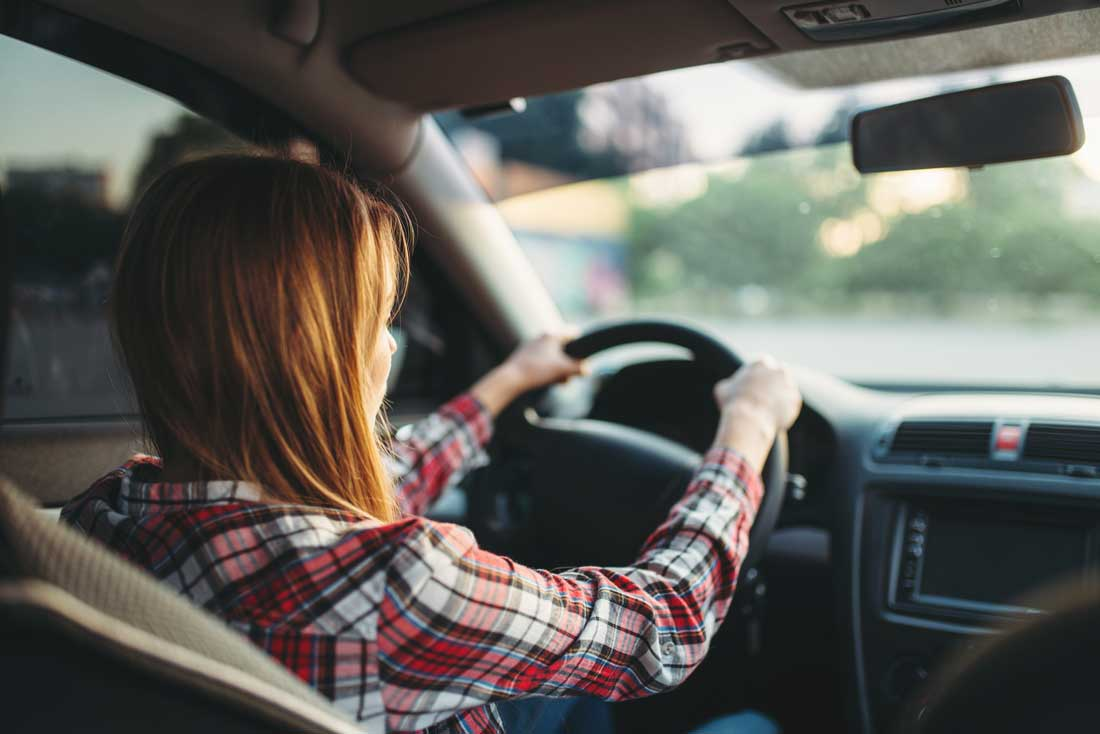 teen girl learning to drive